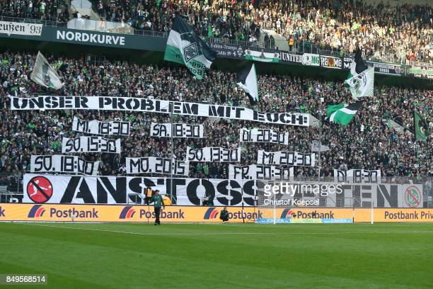 Supporters of Gladbach display banners and voice their anger in response to them any kick of times by the DFB before the Bundesliga match between...