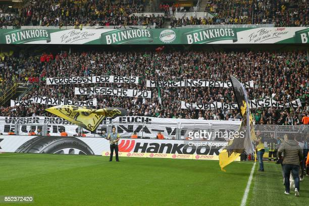 Supporters of Gladbach voice their frustration with the DFB on banners before the Bundesliga match between Borussia Dortmund and Borussia...