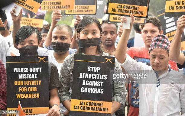 Supporters of Gorkhaland held a peace full protest against the authorities' imposition of Bengali language among the school of Darjeeling where...