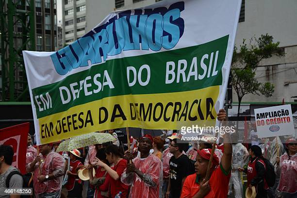 Supporters of government of Dilma Rousseff protest to reject a possible impeachment against President Dilma Rousseff scandalhit oil company Petrobras...