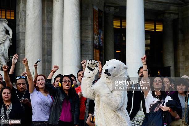 Supporters of Greenpeace light candles against the detention in Russia of 30 activists in front of the Fine Arts palace in Mexico City on November 16...