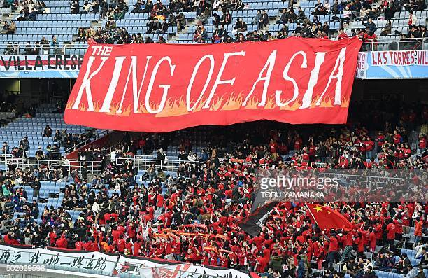 Supporters of Guangzhou Evergrande of China display a huge banner before the start of the thirdplace Club World Cup football match between Guangzhou...