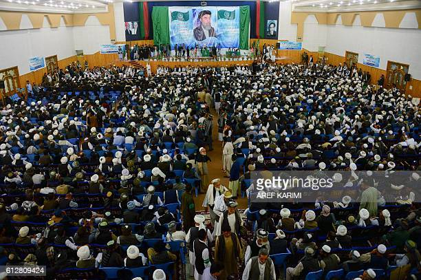 Supporters of Gulbuddin Hekmatyar the leader of HizbiIslami attend a gathering in Herat on October 5 2016 Notorious Afghan warlord Gulbuddin...