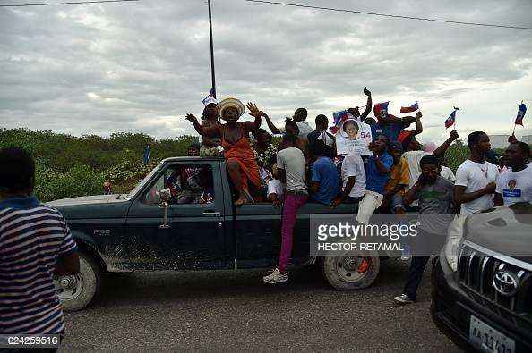 TOPSHOT Supporters of Haitian Lavalas presidential candidate Marysse Narcisse rally on the last day of electoral campaign for the next presidential...