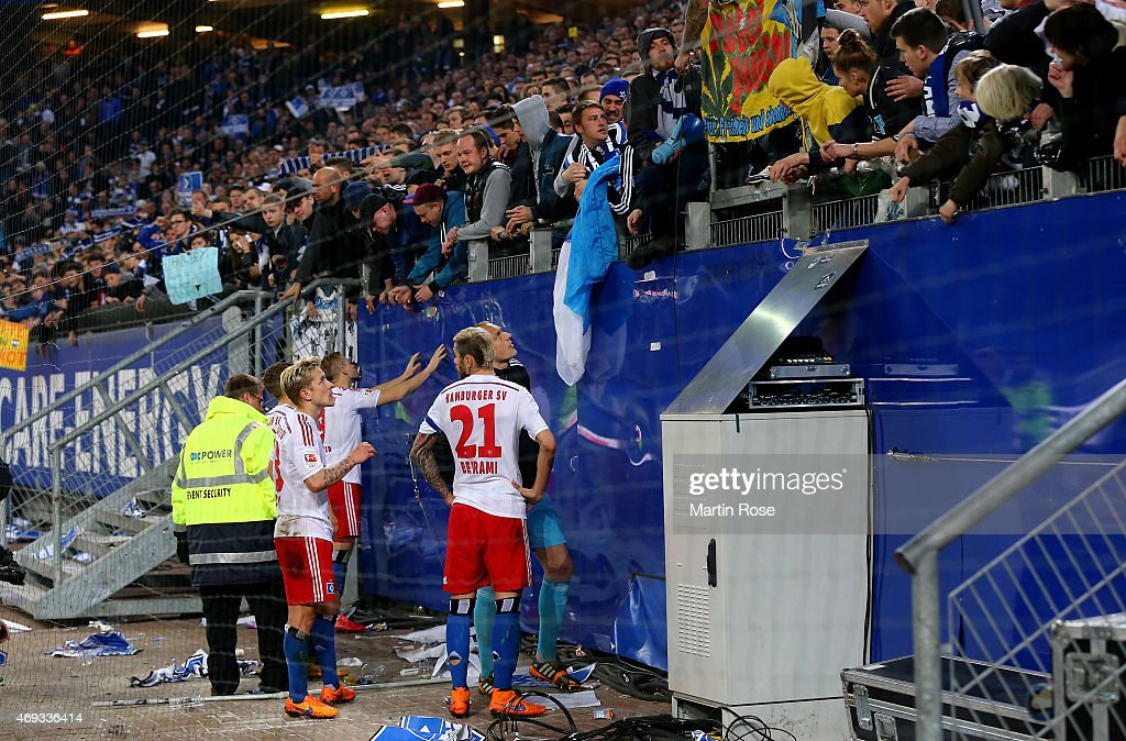 Supporters of Hamburg argue with <a gi-track='captionPersonalityLinkClicked' href=/galleries/search?phrase=Rene+Adler&family=editorial&specificpeople=686184 ng-click='$event.stopPropagation()'>Rene Adler</a>, <a gi-track='captionPersonalityLinkClicked' href=/galleries/search?phrase=Heiko+Westermann&family=editorial&specificpeople=623650 ng-click='$event.stopPropagation()'>Heiko Westermann</a> and <a gi-track='captionPersonalityLinkClicked' href=/galleries/search?phrase=Valon+Behrami&family=editorial&specificpeople=453450 ng-click='$event.stopPropagation()'>Valon Behrami</a> of Hamburg after the Bundesliga match between Hamburger SV and VfL Wolfsburg at Imtech Arena on April 11, 2015 in Hamburg, Germany.
