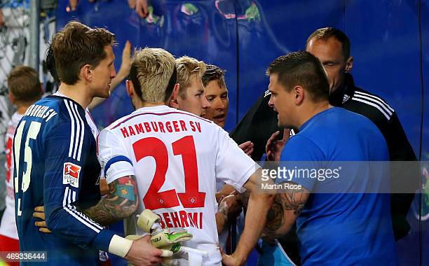 Supporters of Hamburg argue with Rene Adler Heiko Westermann and Valon Behrami of Hamburg after the Bundesliga match between Hamburger SV and VfL...