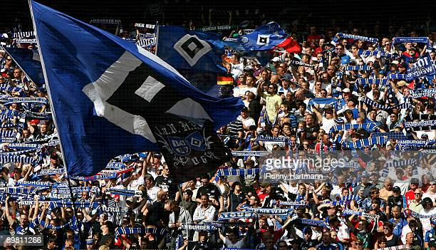 Supporters of Hamburg cheer their team during the Bundesliga match between Hamburger SV and Borussia Dortmund at the HSH Nordbank Arena on August 15...