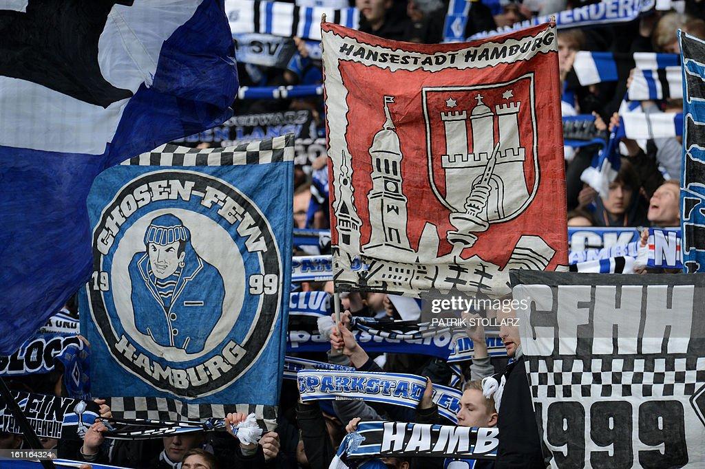 Supporters of Hamburg waves flags and cheer their team during the German first division Bundesliga football match Borussia Dortmund vs Hamburger SV in Dortmund, western Germany, on February 9, 2013. Hamburg won 1-4. AFP PHOTO / PATRIK STOLLARZ AT + 49 69 650050