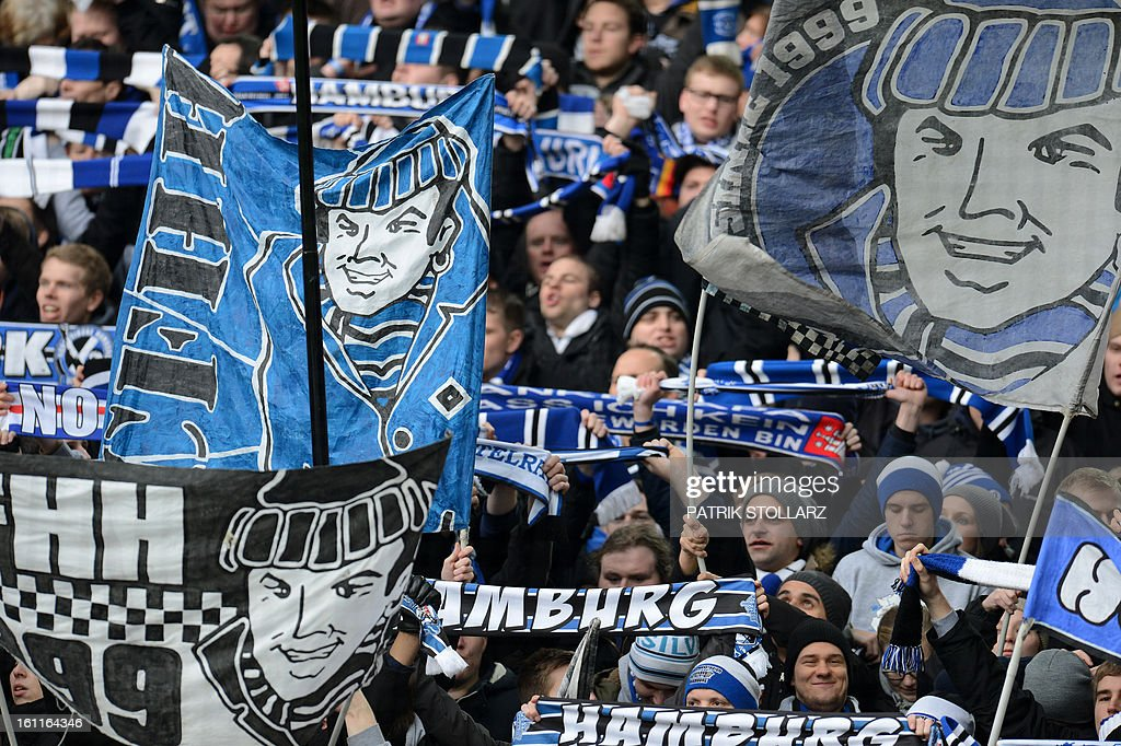 Supporters of Hamburg waves flags and cheer their team during the German first division Bundesliga football match Borussia Dortmund vs Hamburger SV in Dortmund, western Germany, on February 9, 2013. Hamburg won 1-4.
