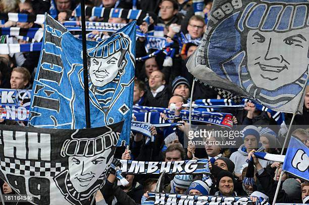 Supporters of Hamburg waves flags and cheer their team during the German first division Bundesliga football match Borussia Dortmund vs Hamburger SV...