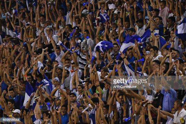 Supporters of Honduras celebrate their team's victory after their 2018 World Cup qualifier football match against Mexico in San Pedro Sula Honduras...