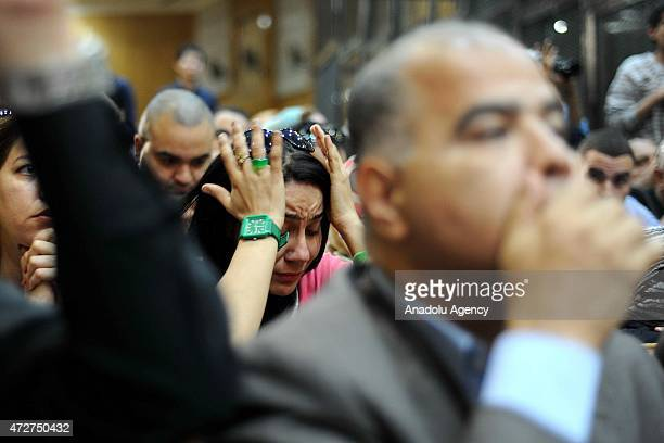 Supporters of Hosni Mubarak get sad during the trial as former president Hosni Mubarak behind bars in Cairo Egypt on May 9 2015 An Egyptian court on...