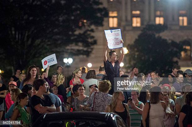 Supporters of House Democrats taking part in a sitin in the House Chamber shout encouragement from outside the US Capitol on June 22 2016 in...