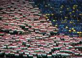 Supporters of Hungary hold up their national flag prior to the Euro 2016 Group F qualifying football match Romania vs Hungary in Bucharest Romania on...