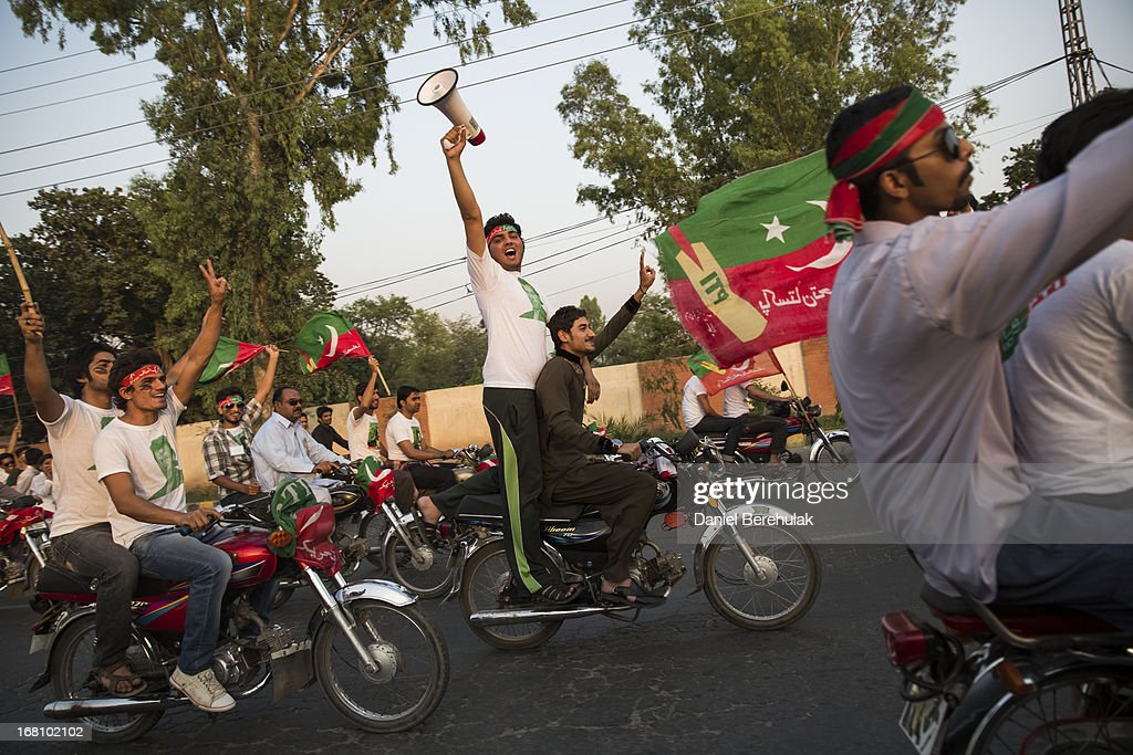 Supporters of Imran Khan, chairman of the Pakistan Tehrik e Insaf (PTI) party, drive in to participate during an election campaign rally on May 05, 2013 in Faisalabad, Pakistan. Pakistan's parliamentary elections are due to be held on May 11. Imran Khan of Pakistan Tehrik e Insaf (PTI) and Nawaz Sharif of the Pakistan Muslim League-N (PMLN) have been campaigning hard in the last weeks before polling.