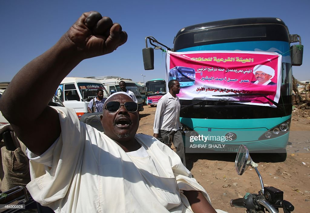 Supporters of incumbent Sudanese President Omar al-Bashir (portrait) attend an electoral campaign rally in Khartoum on February 24, 2015, ahead of the April 13 parliamentary and presidential elections. Campaigning for Sudan's elections started in February 22 with Omar al-Bashir facing little competition for the presidency, a multi-party boycott and the opposition and press facing mounting repression.