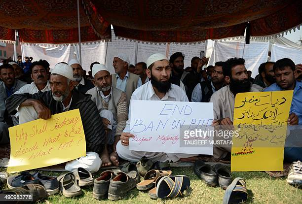 Supporters of independent lawmaker Er Rashid hold placards during a protest against a beef ban in Srinagar on October 2 2015 Er Rashid and supporters...