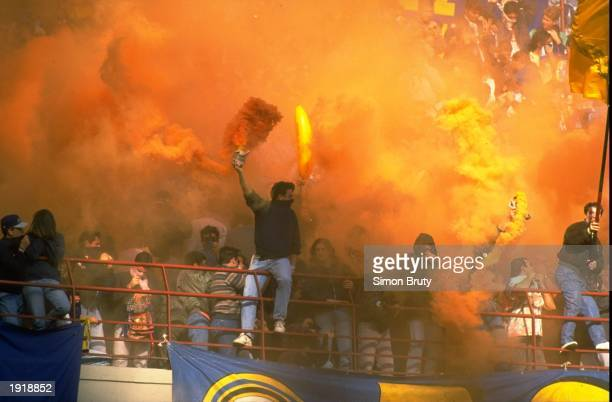 Supporters of Inter Milan cheer on their team during a match at the San Siro Stadium in Milan Italy Mandatory Credit Simon Bruty/Allsport