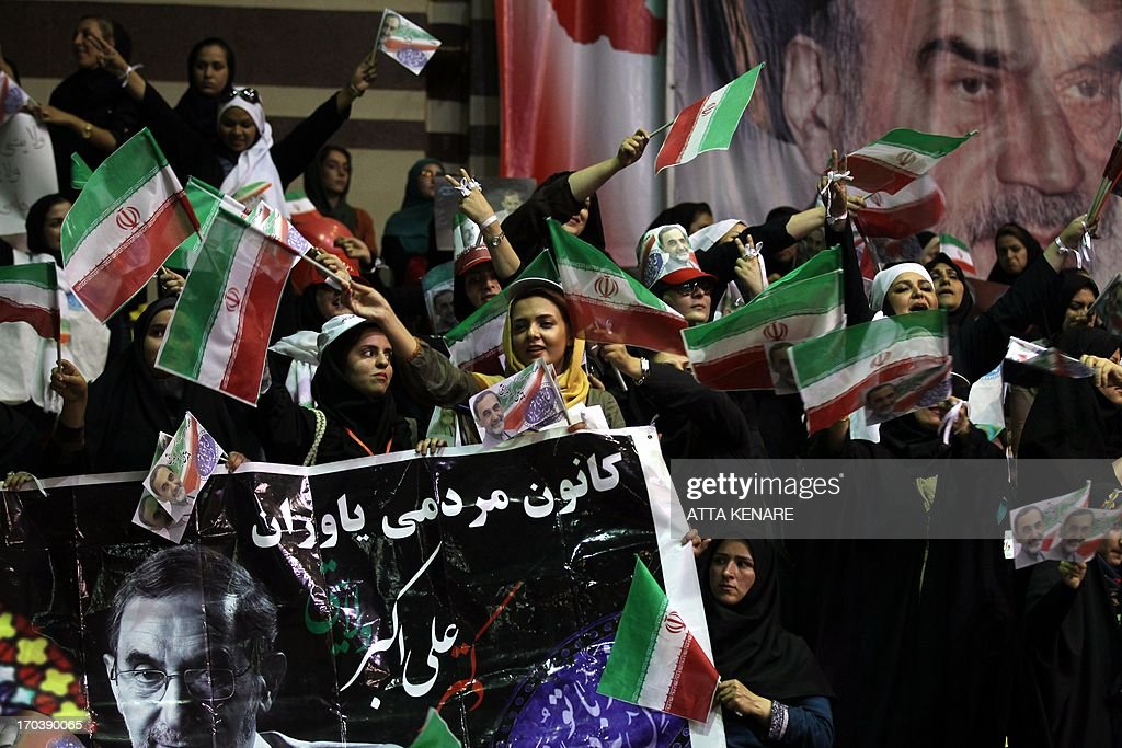 Supporters of Iranian advisor to the supreme leader Ayatollah Ali Khamenei and hopeful conservative presidential candidate, Ali Akbar Velayati attend his campaign rally in Tehran, on June 12, 2013. AFP PHOTO/ATTA KENARE
