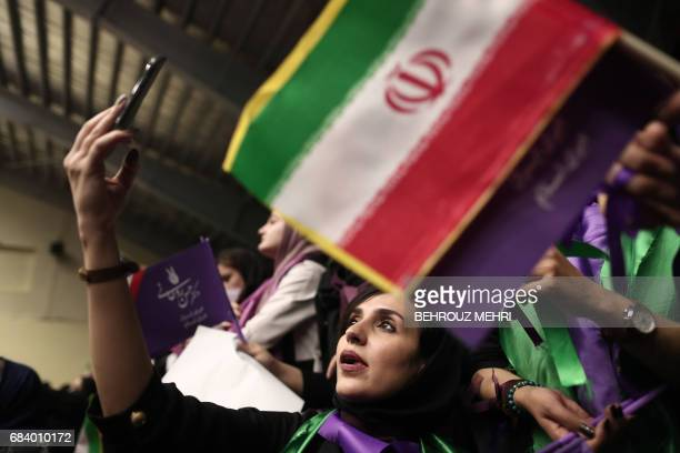 Supporters of Iranian President and candidate in the upcoming presidential elections Hassan Rouhani attend a campaign rally in the northwestern city...