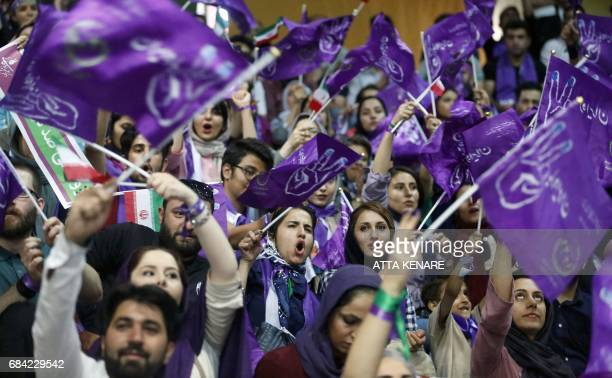 Supporters of Iranian President and candidate in the upcoming presidential elections Hassan Rouhani attend a campaign rally in the capital Tehran on...