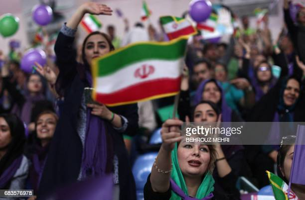 TOPSHOT Supporters of Iranian President and presidential candidate Hassan Rouhani chant slogans during an electoral campaign gathering in the...