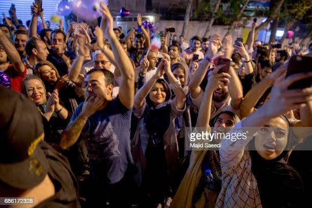 Supporters of Iranian President Hassan Rouhani celebrate after he won the presidential election on May 20 2017 in Tehran Iran Tens of thousands of...