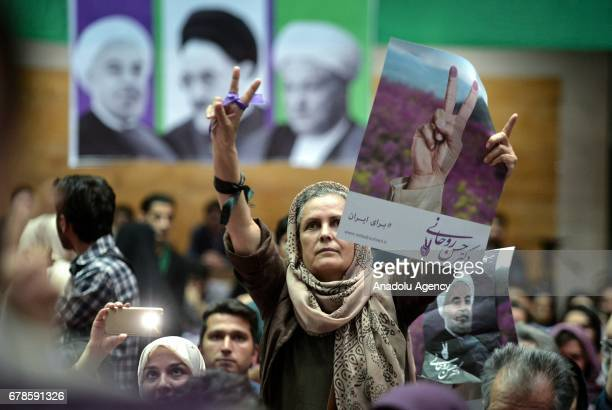 Supporters of Iranian presidential candidate and current Iranian President Hassan Rouhani attend an electoral rally that organized prior to...