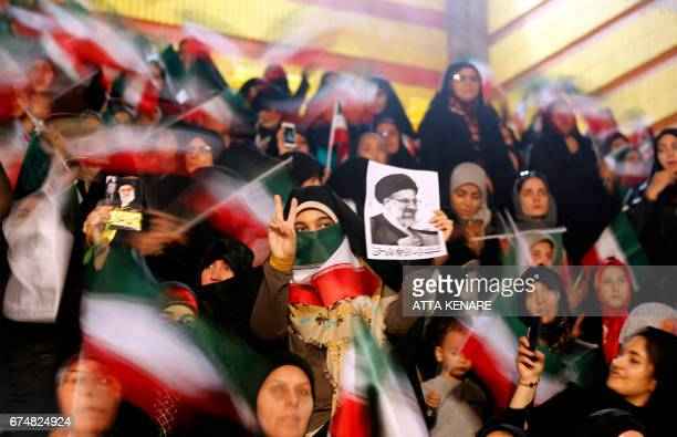 TOPSHOT Supporters of Iranian presidential candidate Ebrahim Raisi attend a campaign rally in the capital Tehran on April 29 2017 / AFP PHOTO / ATTA...