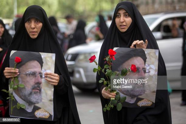 Supporters of Iranian presidential candidate Ebrahim Raisi attend a campaign rally at Imam Khomeini Mosqueon May 16 2017 in Tehran Iran Iran's...