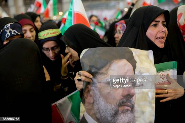 Supporters of Iranian presidential candidate Ebrahim Raisi attend a campaign rally at Imam Khomeini Mosque in the capital Tehran May 16 2017 in...