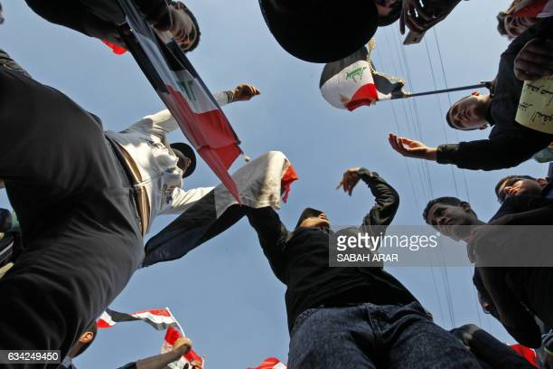 Supporters of Iraqi cleric Moqtada alSadr demonstrate in Baghdad on February 8 2017 to demand electoral reform ahead of a planned provincial vote in...