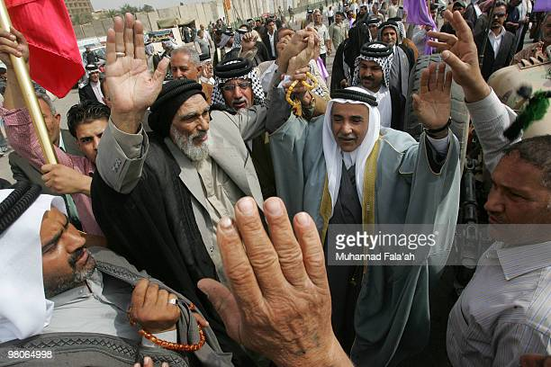 Supporters of Iraqi Incumbent Prime Minister Nouri alMaliki chant antiBaathist slogans during a protest on March 26 2010 in Baghdad Iraq Supporters...