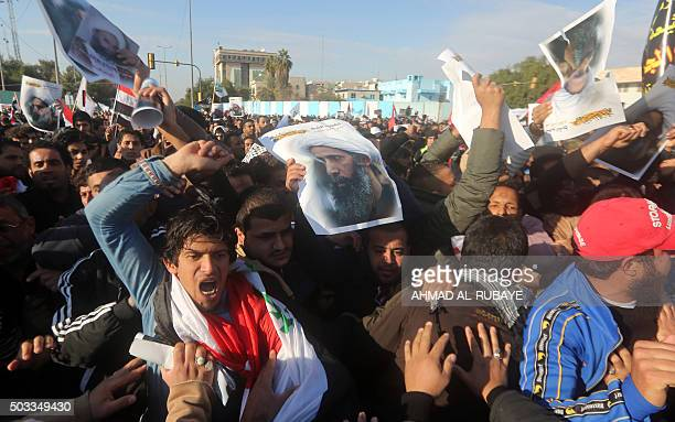 TOPSHOT Supporters of Iraqi Shiite cleric Moqtada alSadr try to enter the Green Zone in the Iraqi capital Baghdad where the Saudi embassy is located...