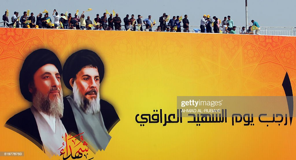 Supporters of Iraqi Shiite Muslim leader Ammar alHakim head of the Islamic Supreme Council of Iraq take part in a rallye commemorating his uncle...