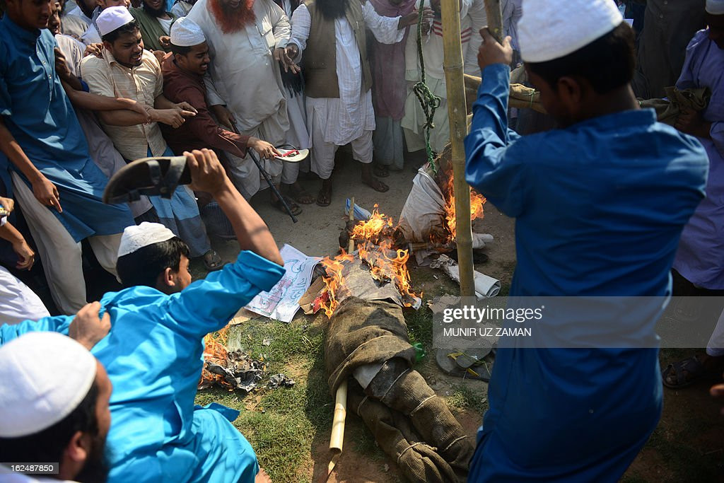 Supporters of Islamic political parties burn and kick an effigy of a blogger inside a madrasa during a nationwide strike in Dhaka on February 24, 2013. The Islamist parties called for a nationwide dawn-to-dusk shutdown on Sunday protesting attacks on demonstrators who were demanding punishment against the 'atheist' bloggers of the Shahbagh movement. AFP PHOTO/Munir uz ZAMAN