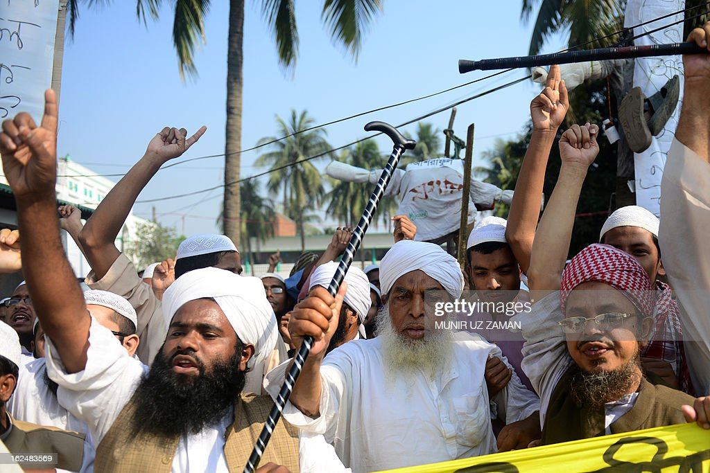 Supporters of Islamic political parties shout slogans inside a madrasa during a nationwide strike in Dhaka on February 24, 2013. The Islamist parties called for a nationwide dawn-to-dusk shutdown on Sunday protesting attacks on demonstrators who were demanding punishment against the 'atheist' bloggers of the Shahbagh movement. AFP PHOTO/Munir uz ZAMAN