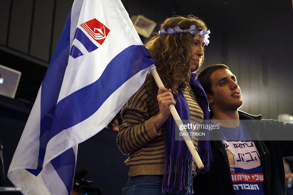 Supporters of Israeli Labor party leader Shelly Yachimovich wave flags on January 22, 2013 at the party's headquarters in Kfar Saba, central Israel. Israeli Prime Minister Benjamin Netanyahu said it was necessary to form the 'broadest possible government' after his Likud-Beitenu list won a narrow election victory, with the centrist Yesh Atid in second place. AFP PHOTO/GALI TIBBON