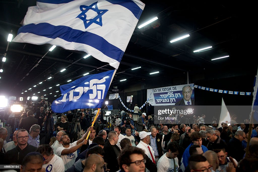 Supporters of Israeli Prime Minister Benjamin Netanyahu celebrate as election results come in at his election campaign headquarters on March 17 2015...