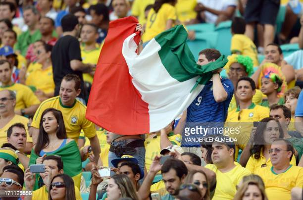 Supporters of Italy display their national flag as Brazilian sit on the stands around them before the start of the FIFA Confederations Cup Brazil...
