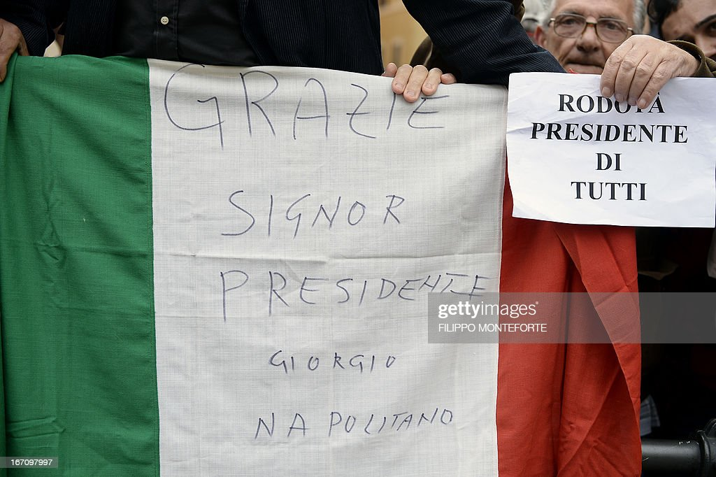 Supporters of Italy's President Giorgio Napolitano hold an Italian flag reading 'Thanks mister President Giorgio Napolitano' and a Five Stars mouvement supporter hold a paper reading 'Rodota President of everybody' as they gather outside the Italian Parliament on April 20, 2013 during the election of the President. Italy's 87-year-old President Giorgio Napolitano on Saturday said he would run for a second term despite earlier ruling out the prospect, following an appeal from the main parties to help defuse an increasingly tense political crisis.'I consider it necessary to offer my availability,' Napolitano said in a statement, as bickering lawmakers prepared for a sixth round of voting in parliament that he is now expected to win by a large margin.
