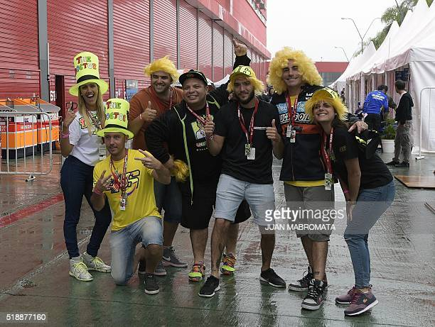 Supporters of Italy's Yamaha biker Valentino Rossi pose at the pits before the warmup of the MotoGP of the Argentina Grand Prix at Termas de Rio...