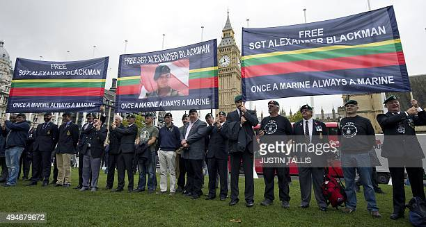 Supporters of jailed British Royal Marine Sergeant Alexander Blackman wear Royal Marine green berets and hold banners on October 28 2015 in...