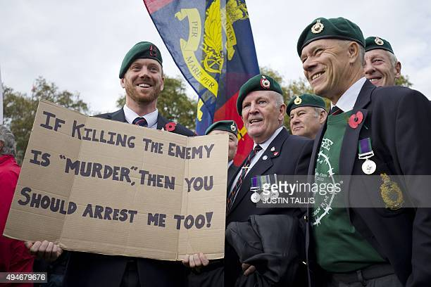 Supporters of jailed British Royal Marine Sergeant Alexander Blackman wear Royal Marine green berets and hold a placard on October 28 2015 in...