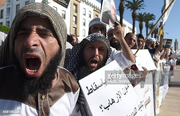Supporters of jailed Salafists shout slogans and hold placards during a demonstration in front of the parliament in Rabat on October 30 calling for...