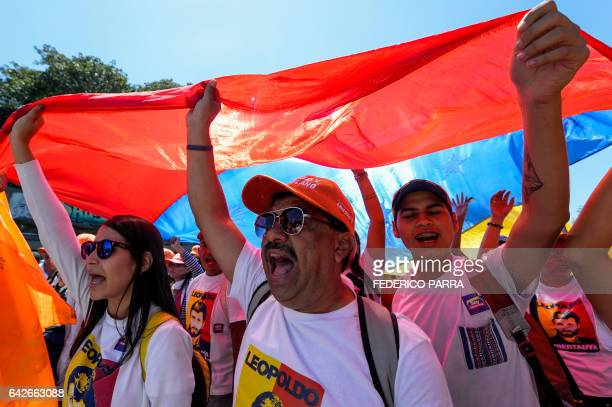 Supporters of jailed Venezuelan opposition leader Leopoldo Lopez shout slogans during a demonstration held on the third anniversary of his arrest on...