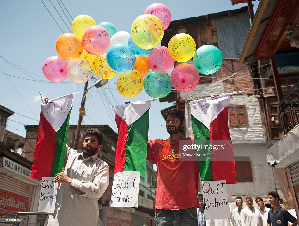 Supporters of Jammu and Kashmir Liberation Front hold up signs and balloons to mark the relaunch of the 'Quit Kashmir' movement in the city centre during a strike against Indian Prime Minister Narendra Modi's visit on July 4, 2014, in Srinagar,the summer capital of Indian administered Kashmir, India. India's newly elected leader, Prime Minister Narendra Modi made his first official trip to Indian-controlled Kashmir, India's only Muslim-majority state, where separatist groups called a strike that closed down shops, businesses, schools, and all traffic. Disputes arose from Prime Minister Narendra Modi's inauguration of a railway line and a plan to review security and development in the Himalayan region dividing India and Pakistan. Reports stated that the restrictions were imposed to prevent any violent protests by separatist groups who oppose Indian rule.
