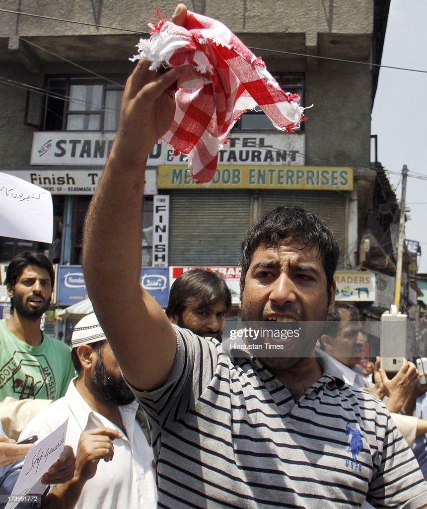 Supporters of Jammu Kashmir Liberation Front shout slogans during a protest against killing of 4 people in BSF firing on July 18, 2013 in Srinagar, India. Four people were killed today when security personnel opened fire at a mob that had gathered at a BSF camp in Ramban district protesting against alleged manhandling of an Imam of the area by the force. Curfew would be imposed in Srinagar and all other major towns in the Kashmir Valley from Friday morning as a precautionary measure.