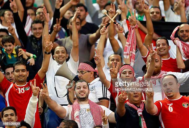 Supporters of Jordanian national football team cheer their team during the 2015 Asian Cup qualifying football match Oman versus Jordan on January 31...