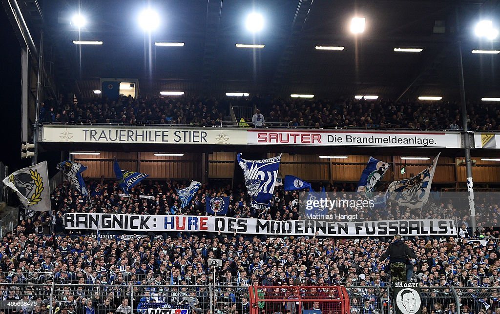 Supporters of Karlsruher SC hold up a banner against Manager Ralf Rangnick of RB Leipzig during the Second Bundesliga match between Karlsruher SC and...
